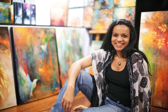 Malini Parker with Paintings